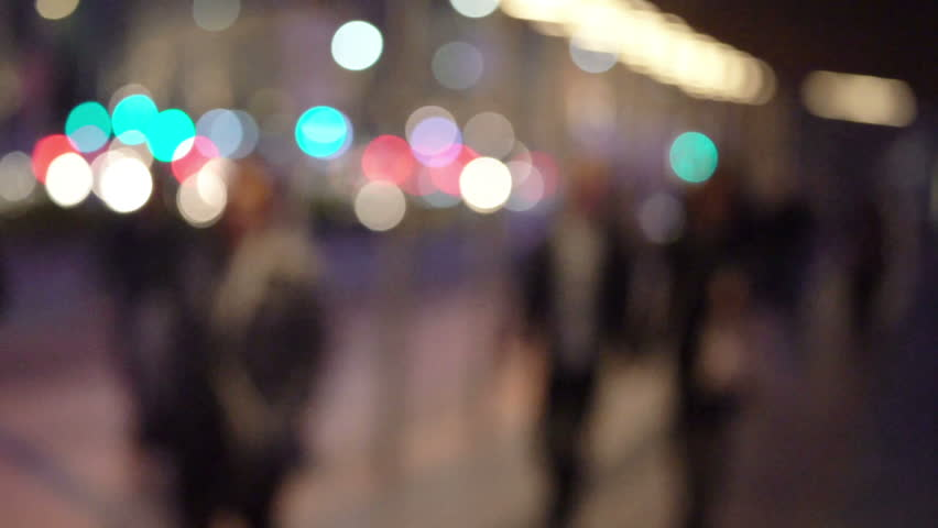 People walking in city night background.  Out of focus background from busy big city with people crossing street.  | Shutterstock HD Video #31779181