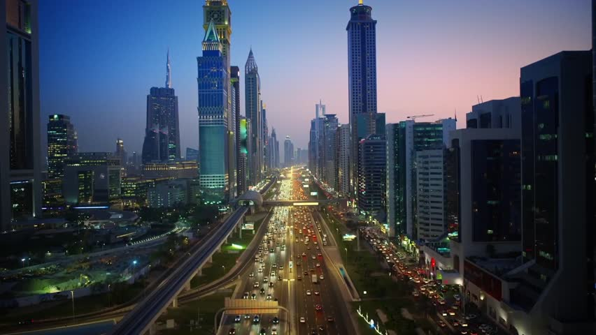 Incredible aerial drone view on huge futuristic skyscraper building of Dubai big city lights warm pink evening sunset