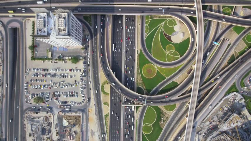 Glorious top aerial drone shot of long busy highway road and modern skyscraper building in urban Dubai city panorama