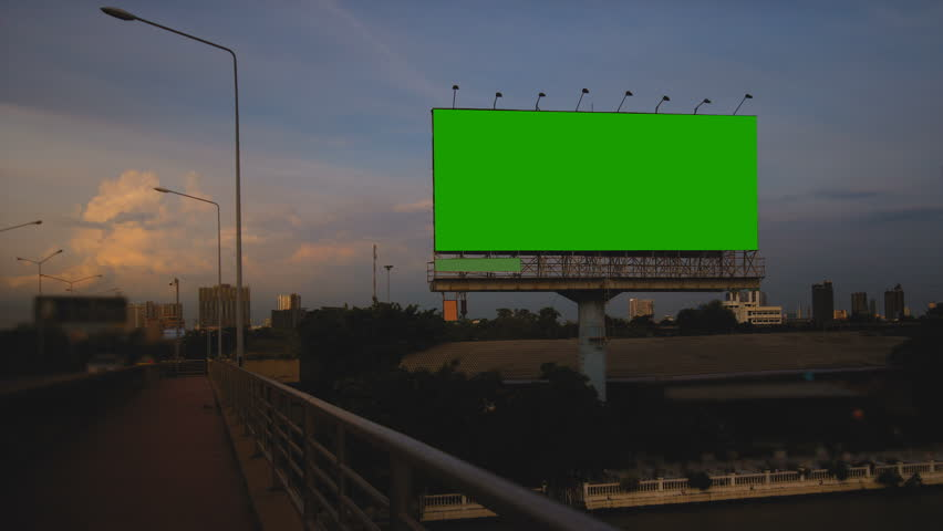 Billboard green screen on sidelines of the bridge with traffic at evening, time lapse. | Shutterstock HD Video #31793008