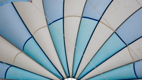 Abstract of blue and white parachute or parasailing in transport and travel concept.