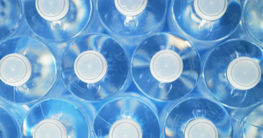 High angle view of plastic water bottles in a row. Concept of industrial production, recycling, disposal of waste, and environmental conservation. Dolly shot. | Shutterstock HD Video #31807564