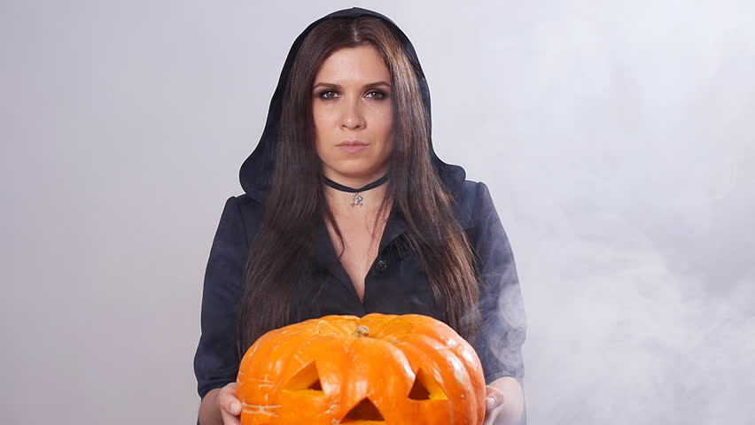 Woman is standing with the pumpkin in smoke | Shutterstock HD Video #31824604