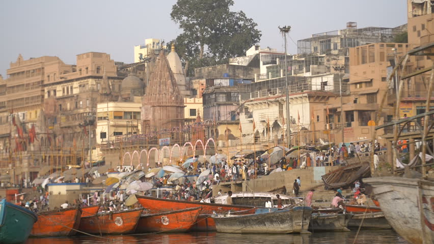 Panning shot of colourful boats moored by a ghat | Shutterstock HD Video #31828444