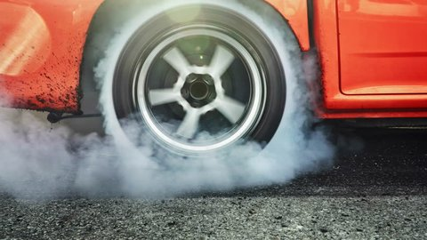 Drag racing car burn tires at start line