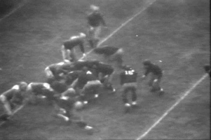 CIRCA 1930s - The University of Michigan and Ohio State face off in a 1933 football game.