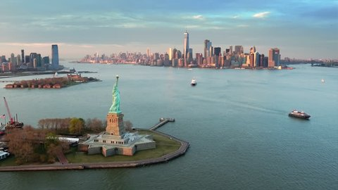 Aerial view of the Statue of Liberty at dusk. Manhattan and New Jersey skyline. New York City, United States. Shot from a helicopter.