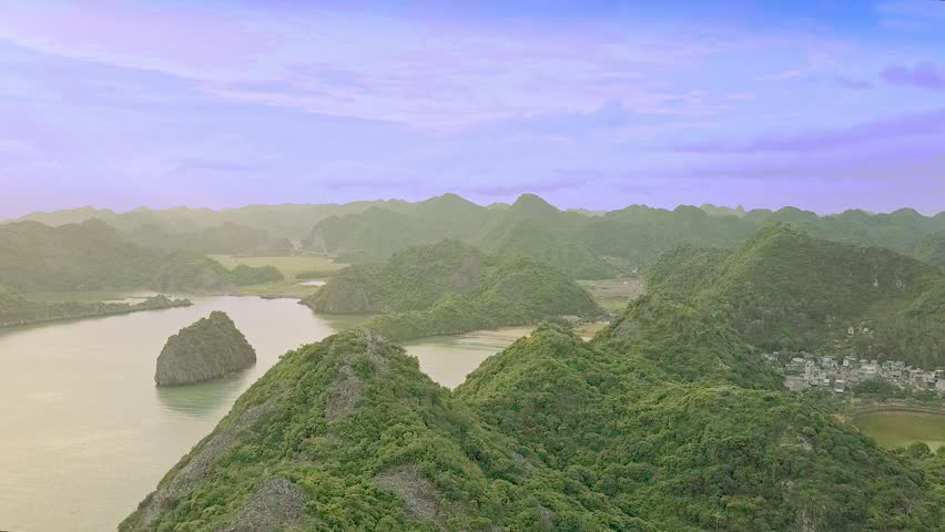 magnificent aerial view hilly small islands spread in beautiful ocean under pictorial blue sky