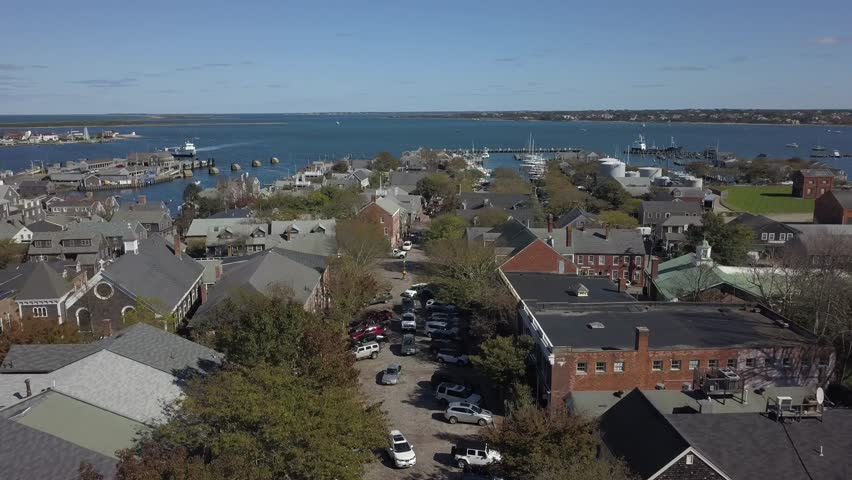 Nantucket Village close AERIAL. Nantucket, a tiny, isolated island off Cape Cod. Long run shot, can be spead up.