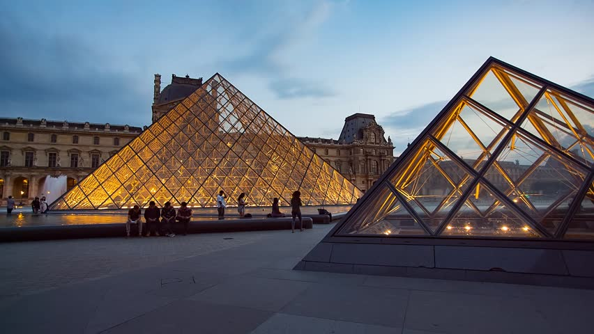 PARIS, FRANCE - JUNE 11, 2017 : Louvre museum with pyramid in twilight | Shutterstock HD Video #31936714