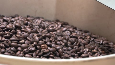 Closeup view of bucket of coffee after roasting process