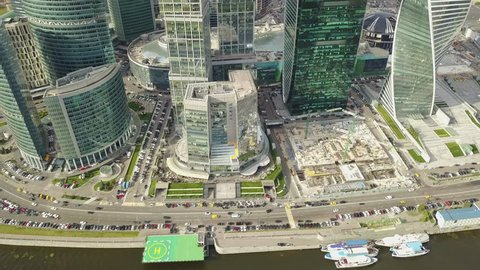 4K aerial high quality aerial video of Moscow City area, International business center, Moscow River with bridge, skyscrapers and boats along the river in Russia on cloudy quiet autumn September day
