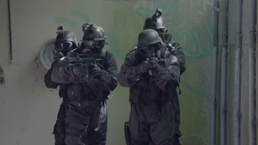 A Special Force Team walk through a open corridor. | Shutterstock HD Video #32000734