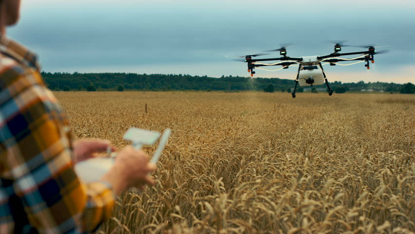 Smart farmer use drone for spray pesticide field. Shot in Red Epic Dragon