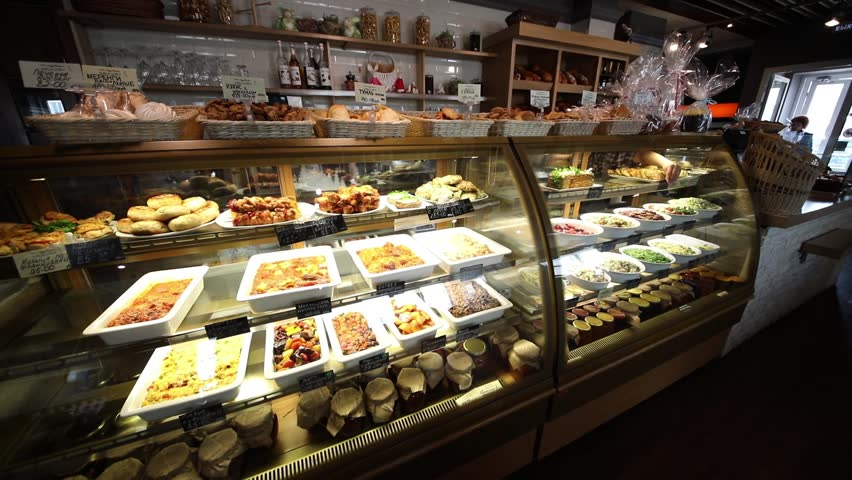 Showcase with pastries and salads in a cafe-bakery, slow motion