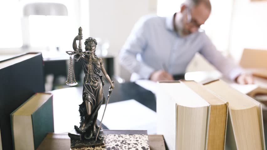 The Statue of Justice - lady justice goddess of Justice in lawyers office - smooth tracking shot