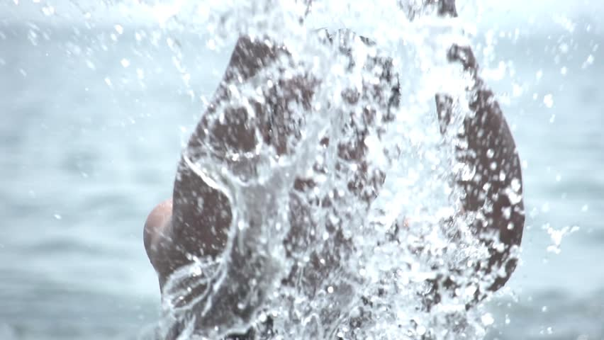 man in the water. handsome male model in water. fresh splashing water. slow motion