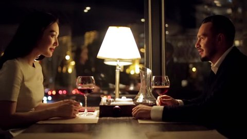Young Couple Toasting Wine Glass In Luxury bar. Dating.