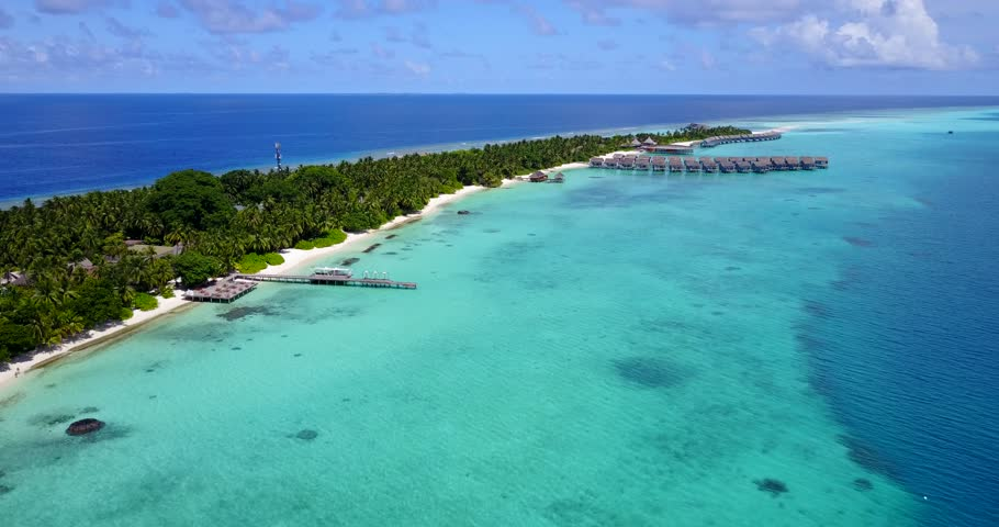 v09452 five 5 star resort water bungalows in Maldives with drone aerial flying view on white sand beach on tropical island