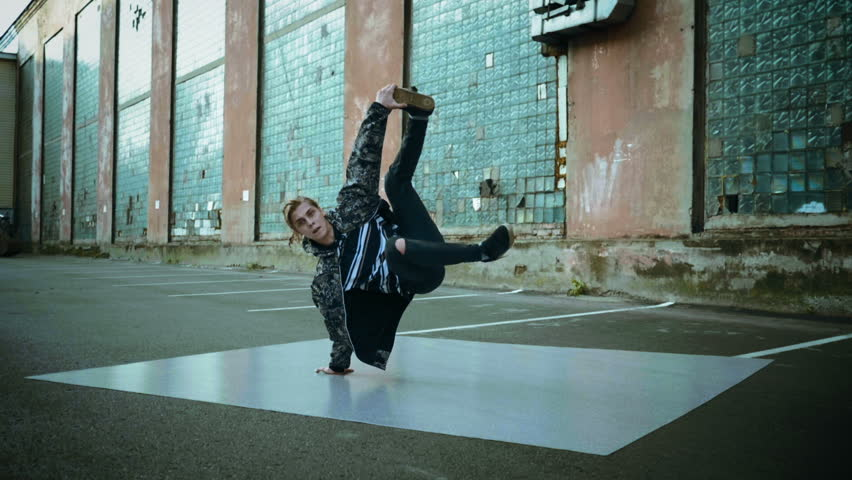 Hip-hop and breakdance. Breakdancer dancing in the street. Slow motion. HD