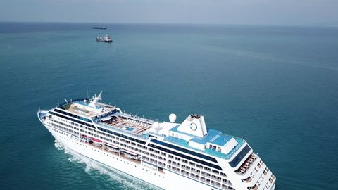 East Mediterranean - 23 Oct, 2017: Aerial view of luxury large cruise ship sails in full speed on open water, top down view of swimming pool and deck - the Nautica