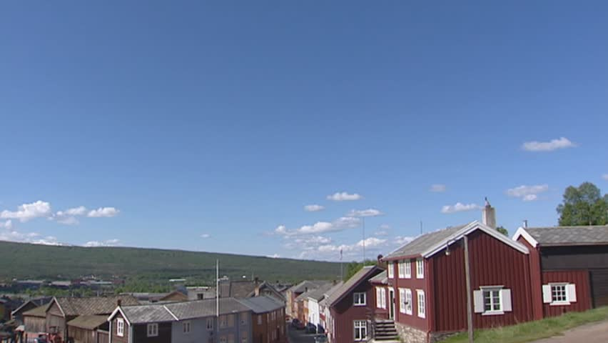 ROROS, RØROS, NORWAY: pan skyline village of Røros. Røros Mining Town and the Circumference is officially designated by UNESCO as World Heritage Site | Shutterstock HD Video #3213454