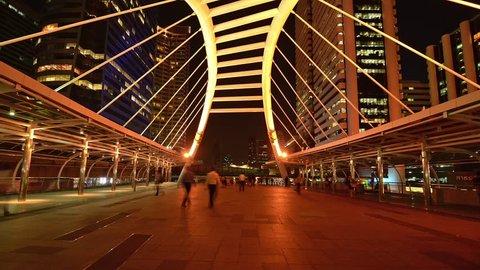 Timelapse of people walking on skybridge