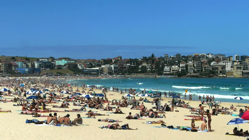 Thousands pack Bondi Beach on a hot summer day.