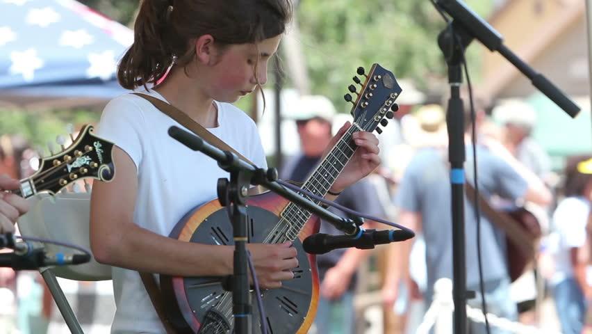 AGOURA HILLS, CA - MAY 20: Mandolin winner, Anya Sturm, 11, plays at the Topanga Banjo & Fiddle Festival in Agoura Hills on May 20, 2012. The long running festival is in its 52nd year.