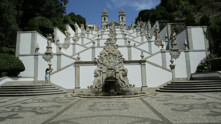 The famous baroque staircase and fountain that zigzags up the hill towards the church of Bom Jesus do Monte, a popular pilgrimage site in northern Portugal. Tenoes in Braga. Blue sky, sunny day.