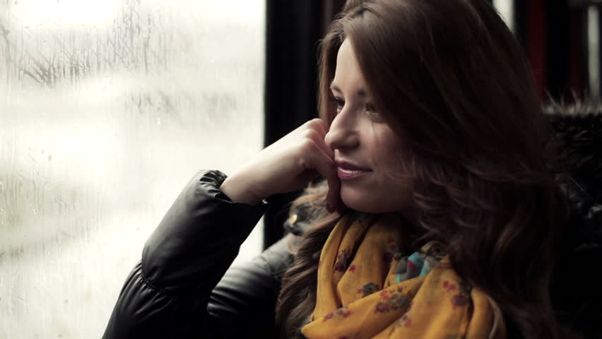 Pensive young woman riding the tram, steadicam shot