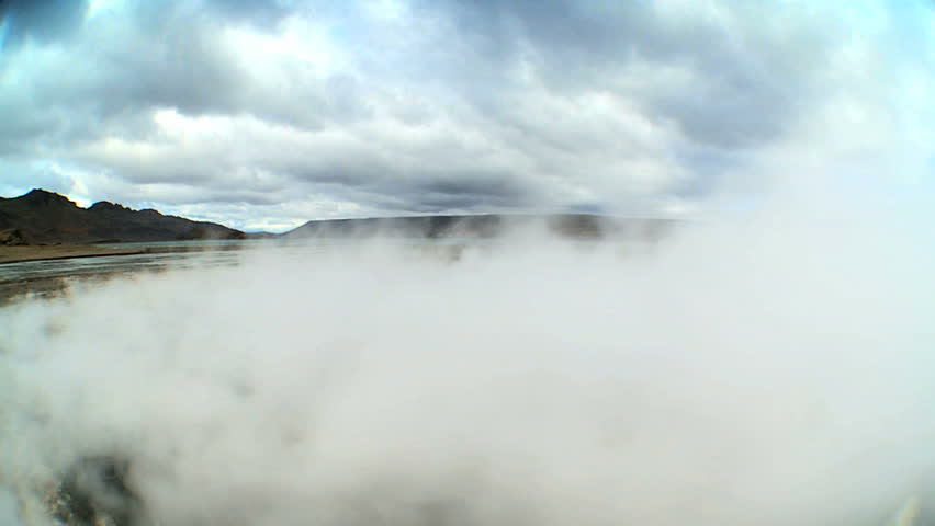Steam coming from hot underground volcanic springs erupting to the surface | Shutterstock HD Video #3224347