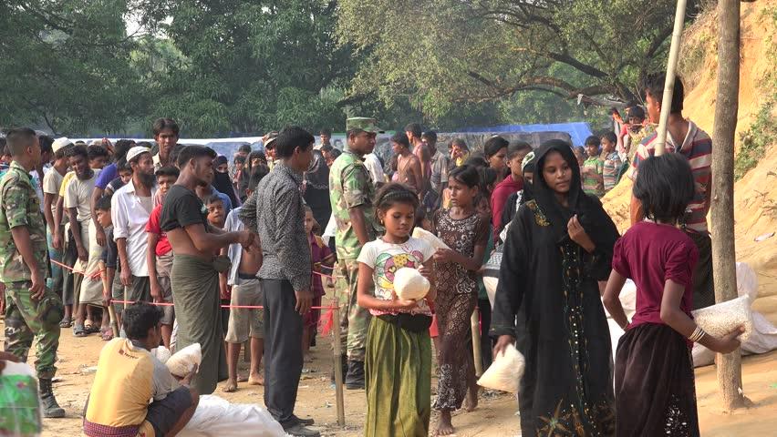 TEKNAF, BANGLADESH - OCTOBER 25, 2017: A busy unpaved dirt road in Katuapalong, the main Rohingya Refugee camp in Bangladesh