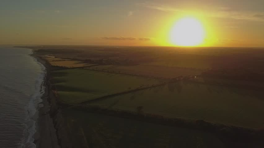 Stunning high altitude aerial shot of the Suffolk coastal landscape at sunset