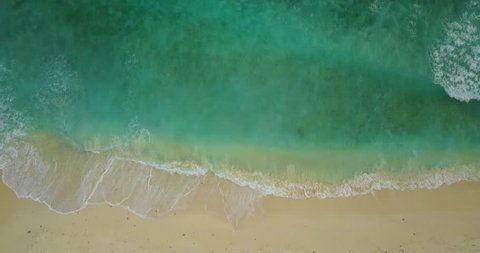 v11155 waves water texture breaking and crashing with drone aerial flying view of aqua blue and green clear sea ocean