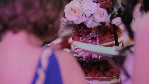 Detail of wedding cake cutting by newlyweds Wedding cake