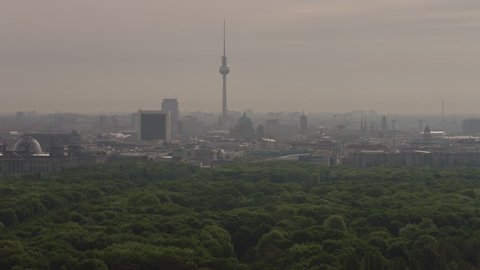 May, 2017 Berlin, Germany. Berlin skyline aerial, TV Tower, Berliner Dome, Reichstag, Brandenburg Gate, park, trees, pan over to the Cultural center on a hazy day.