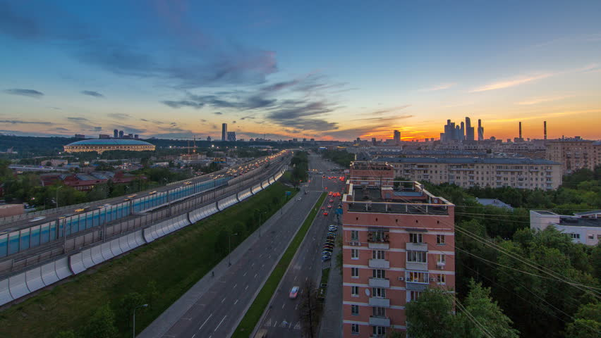 The Third Ring Road traffic after sunset day to night transition timelapse aerial view from rooftop. Skyscrapers and stadium on background. The Third Ring is Moscow's newest beltway, located between | Shutterstock HD Video #32334835