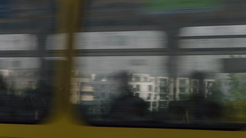 May, 2017 Berlin, Germany. Fast moving S-bahn flies by with Potsdamer Platz skyline behind it during a sunny day