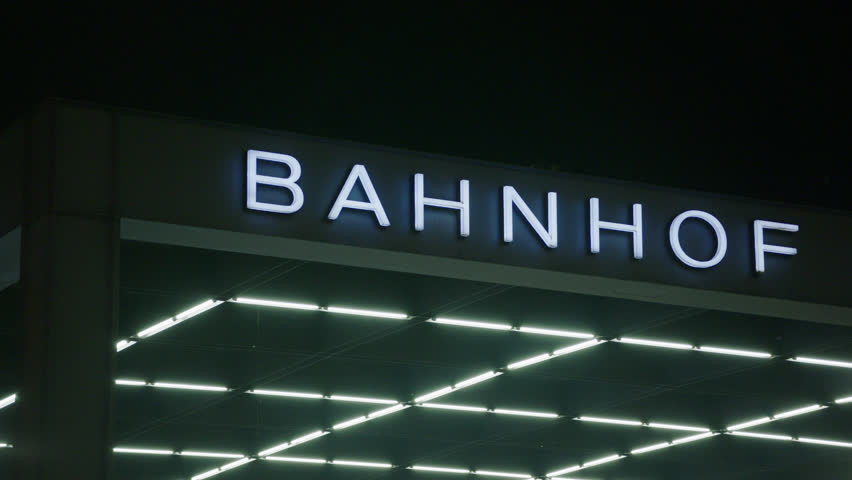 May, 2017 Berlin, Germany. Potsdamer Platz Bahnhof station sign at night glowing in the dark pan across. | Shutterstock HD Video #32341474
