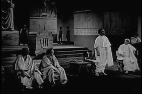 CIRCA 1940s - Two Senators in Ancient Rome debate battle tactics, as portrayed in 1940.