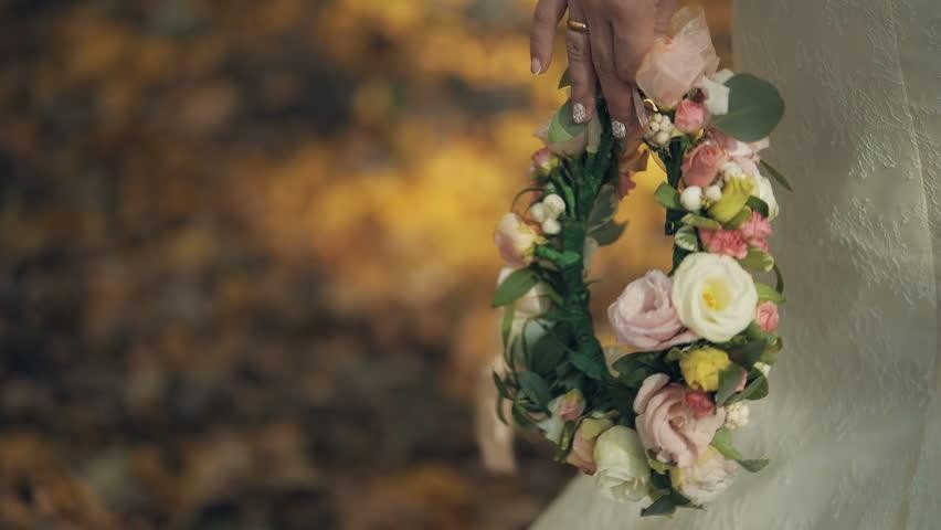 Bride holds wreath of flowers in her hand | Shutterstock HD Video #32372851