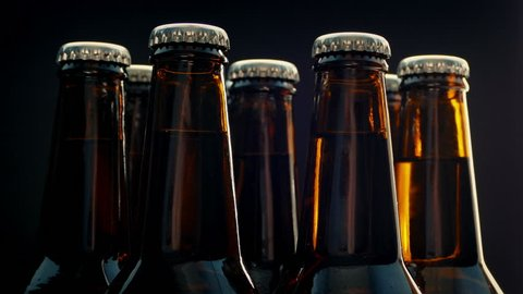 Beer Bottles Rotating On Black Background
