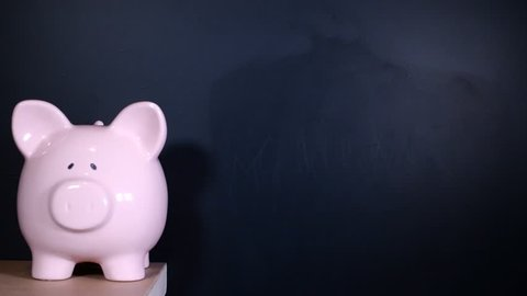 Finances written on a chalkboard by financial expert