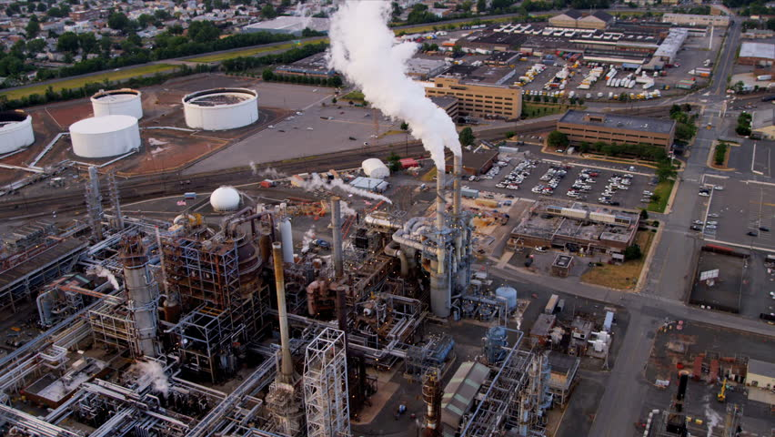 Aerial view of storage tanks and Industrial refinery producing supplying oil and gas, North America