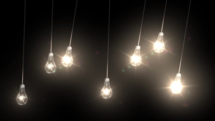 seven lit light bulbs swing