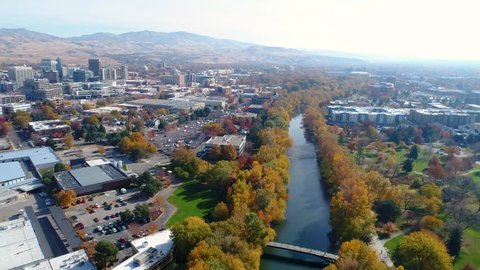 Beautiful view of a river in fall and the Boise Idaho skyline