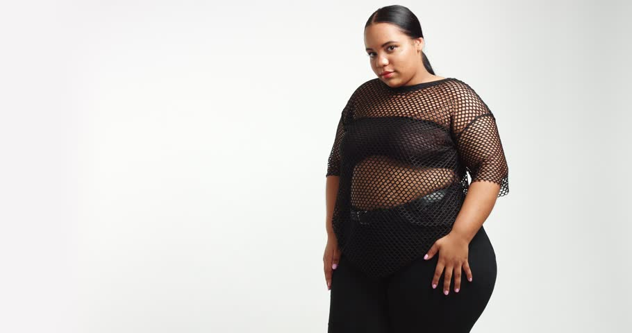 dancing beautiful young plus size model in black short dress with