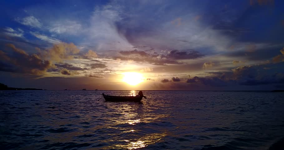 V14957 silhouette sailing boat at sunset sunrise with beautiful sky and sea on island beach | Shutterstock HD Video #32489044