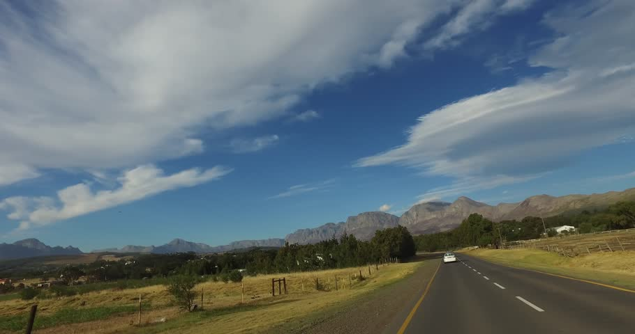 CAPETOWN,SOUTH AFRICA - CIRCA February 2017 :Driving along in the Cape with view of mountains and trees